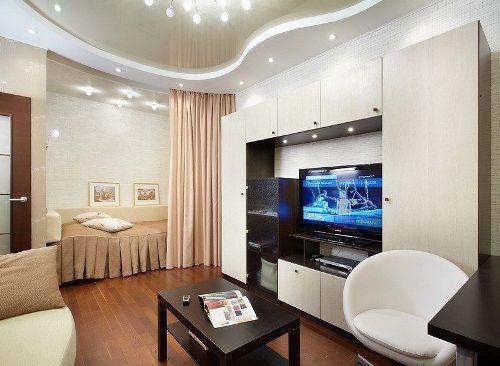 Совмещенные спальня и гостиная. Фото