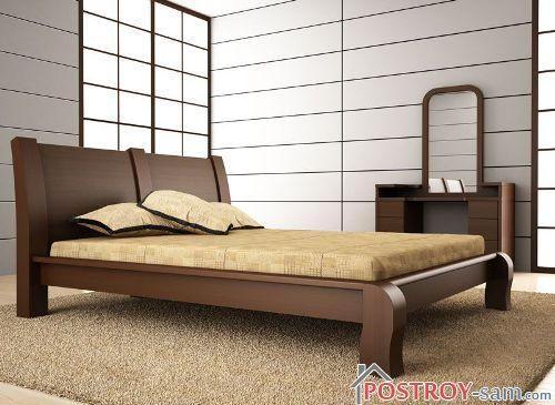 Кровать из массива дерева — основной предмет интерьера спальни