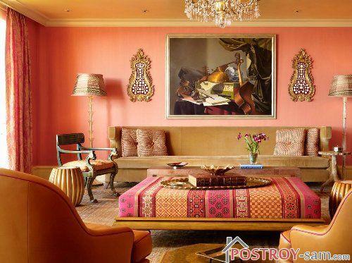 Оранжевый цвет в интерьере гостиной фото